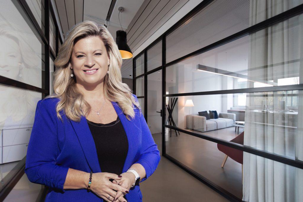 Katharine in a business hallway